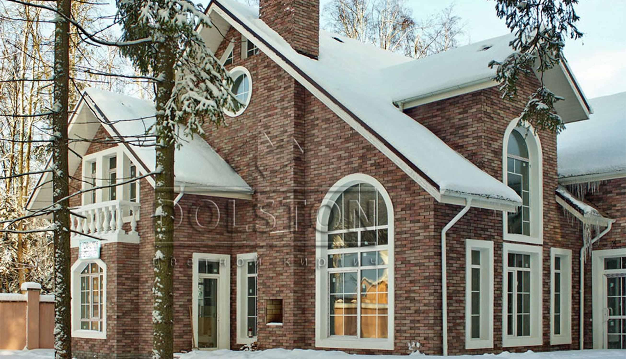 Облицовка дома плиткой под искусственный камень - фото № 23